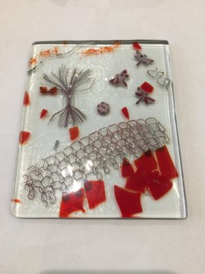 Glass tile including copper wire, copper sheet, glass eggshell. All red colours