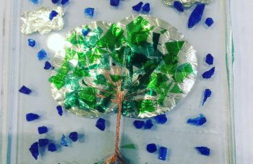 Glass plate with tree, bird and flower detail
