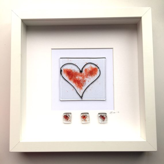 Large red glass heart with 3 smaller heart glass pieces