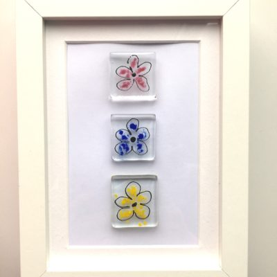 Hand made glass , 3 glass flowers in , pink, blue and yellow