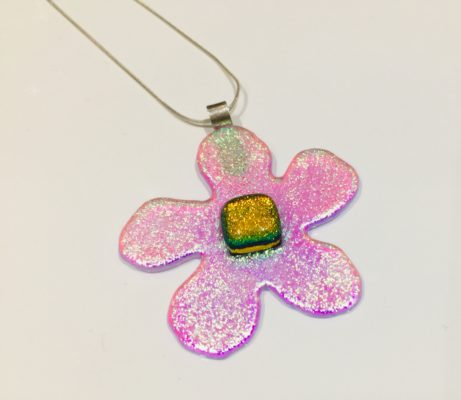 Dichroic clear glass flower, clear pnik with god/rnage centre on a sterling silver chain