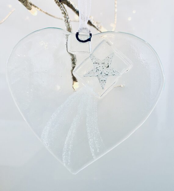 Fused glass heart with silver star decoration and white trail detial.